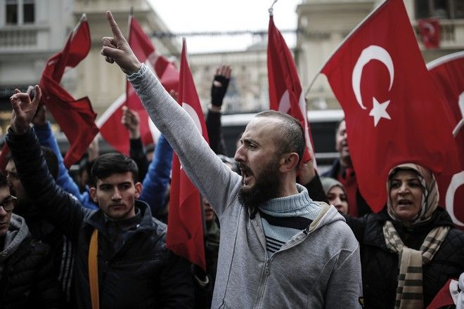 A group of Turks protest outside the Dutch consulate in Istanbul, Sunday, March 12, 2017. Turkish President Recep Tayyip Erdogan says he appropriately accused the Dutch government of