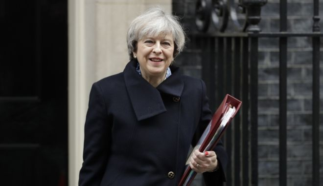 FILE - In this file photo dated Wednesday, March 1, 2017, British Prime Minister Theresa May leaves 10 Downing Street in London, to attend Prime Minister's Questions at the Houses of Parliament. The British government appears to be facing more opposition to its plans for leaving the European Union, as it seems likely Tuesday March 7, 2017, that Parliament's unelected House of Lords may pass an amendment to require Parliament to approve Britain's exit deal with the EU. (AP Photo/Matt Dunham, FILE)