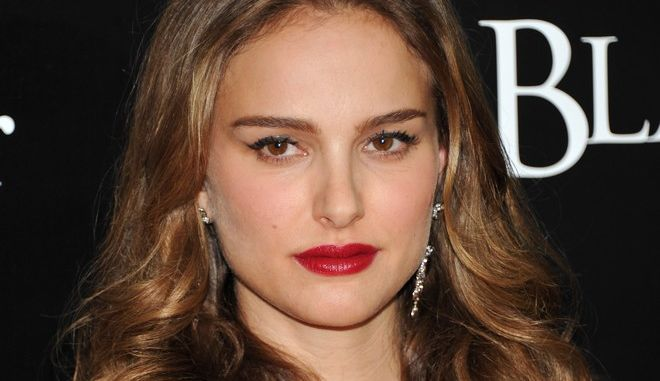 """FILE - In this Nov. 30, 2010 file photo, actress Natalie Portman attends the premiere of """"Black Swan"""" at the Ziegfeld Theatre in New York. Portman was nominated for a Golden Globe for best actress, Tuesday, Dec. 14, 2010, for her role in """"Black Swan."""" The Golden Globe awards will air on Jan. 16 on NBC. (AP Photo/Evan Agostini, file)"""