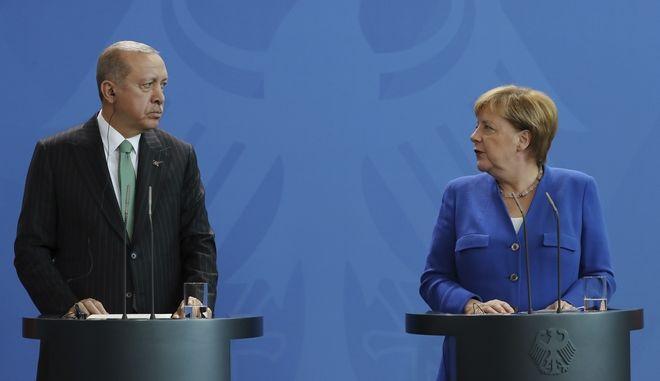 H Γερμανίδα καγκελάριος Άνγκελα Μέρκελ και ο πρόεδρος της Τουρκίας Ρετζέπ Ταγίπ Ερντογάν