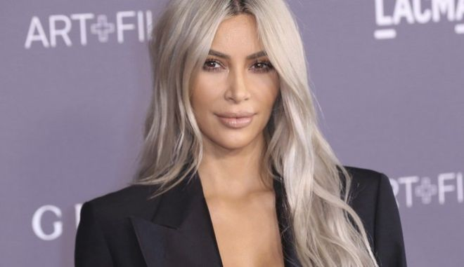FILE - In this Nov. 4, 2017 file photo, Kim Kardashian West arrives at the LACMA Art + Film Gala at the Los Angeles County Museum of Art in Los Angeles. West is promoting Screenshop, which dishes up a range of shoppable fashion and accessory options based on a phone screen grab a user takes from social media or anywhere else. (Photo by Willy Sanjuan/Invision/AP, File)