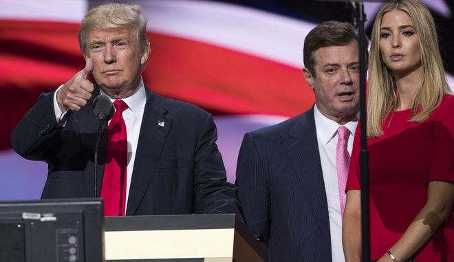 FILE - In this July 21, 2016 file photo, then-Trump Campaign manager Paul Manafort stands between the then-Republican presidential candidate Donald Trump and his daughter Ivanka Trump during a walk through at the Republican National Convention in Cleveland.  Last August, a handwritten ledger surfaced in Ukraine with dollar amounts and dates next to the name of Paul Manafort, who was then Donald Trump's campaign chairman. Ukrainian investigators called it evidence of off-the-books payments from a pro-Russian political party, and part of a larger pattern of corruption under the country's former president. Manafort, who worked for the party as an international political consultant, has publicly questioned the ledger's authenticity.  (AP Photo/Evan Vucci, File)