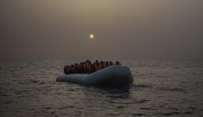 CORRECTS YEAR TO 2017 INSTEAD OF 2016 - African refugees and migrants, mostly from Sudan and Senegal, wait aboard a rubber boat out of control to be assisted by an NGO, 25 miles north of Sabratha, off the Libyan coast, early in the morning on Thursday, Feb. 23, 2017. (AP Photo/Santi Palacios)