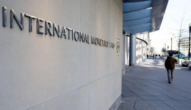 """The International Monetary Fund (IMF) headquarters is seen Monday, Dec. 19, 2016, in Washington. The International Monetary Fund's managing director, Christine Lagarde, was convicted Monday of negligence by a special French court for her role in a contentious and generous arbitration award in 2008 to a politically connected tycoon.  The Washington-based IMF said after Monday's verdict that its executive board would meet soon """"to consider the most recent developments.""""   (AP Photo/Cliff Owen)"""