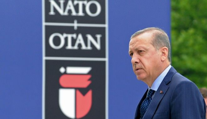 Turkey's President Recep Tayyip Erdogan arrives for sessions on the second day of the NATO Summit in Warsaw, Poland, Saturday, July 9, 2016. U.S. President Barack Obama and leaders of the 27 other NATO countries are taking decisions in Warsaw on how to deal with a resurgent Russia, violent extremist organizations like Islamic State, attacks in cyberspace and other menaces to allies' security. (AP Photo/Alik Keplicz)