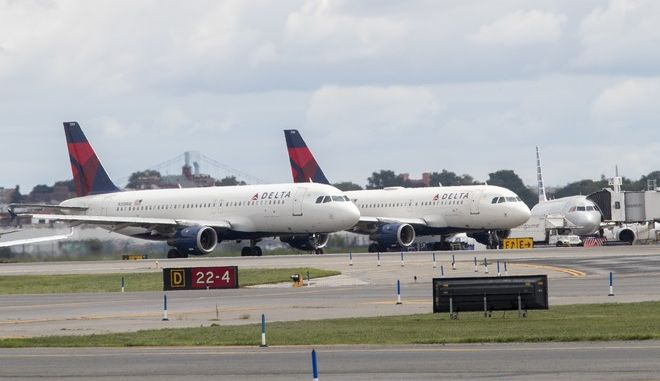 Delta Air Lines airplanes line the tarmac  ahead of a groundbreaking ceremony of the construction on Delta Air Lines $4 billion, 37-gate facility at LaGuardia Airport, Tuesday, Aug. 8, 2017, in the Queens borough of New York. (AP Photo/Mary Altaffer)