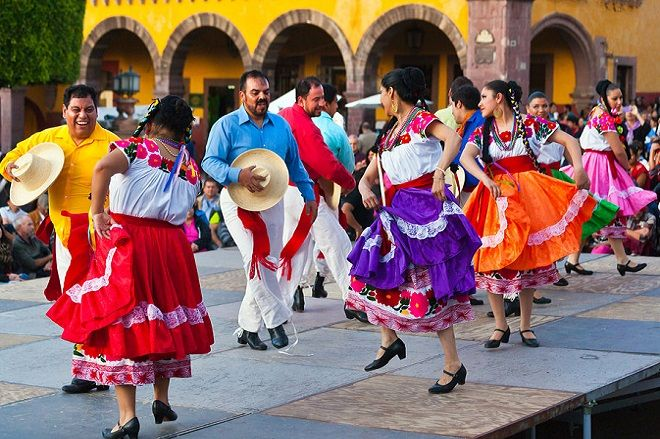 Dancers Perform In The Jardin Or Central Square During The Annual Folk Dance Festival, San Miguel De Allende, Mexico. (Photo by: Education Images/UIG via Getty Images)