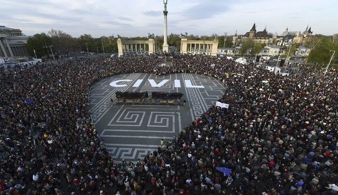 People gather to protest in Heroes Square in Budapest, Hungary, Wednesday April 12, 2017. Tens of thousands of protesters have demonstrated in Hungary to oppose government policies that are seen as limiting academic freedom and intimidating civic groups that receive foreign funding. (Zoltan Balogh/MTI via AP)