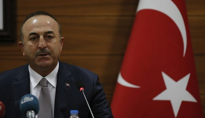 """Turkey's Foreign Minister Mevlut Cavusoglu speaks to the media during a joint news conference with Palestinian Foreign Minister Riyad al-Maliki at the Ataturk Airport in Istanbul, Wednesday, Dec. 20, 2017. The Turkish and Palestinian foreign ministers are accusing the United States of intimidation after the U.S. ambassador to the United Nations warned countries that the U.S. """"will be taking names"""" during a U.N. General Assembly vote on a resolution rejecting President Donald Trump's decision to recognize Jerusalem as Israel's capital.(AP Photo/Emrah Gurel)"""