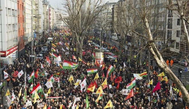 Kurdish immigrants and supporters protest against a Turkish military operation in a Kurdish enclave in northern Syria, in Cologne, Germany, Saturday, Jan. 27, 2018. Police say some 7,000 protesters are demonstrating in the western German city of Cologne, which is one of the centers of the Kurdish community in Germany. (Rainer Jensen/dpa via AP)