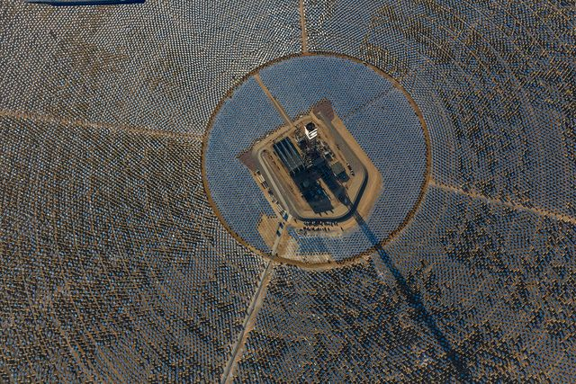 IVANPAH, CALIFORNIA, APRIL 05 2013: An aerial view of Tower 1 and its heliostats at  the Ivanpah Solar Power Facility. The top of Tower 1's is