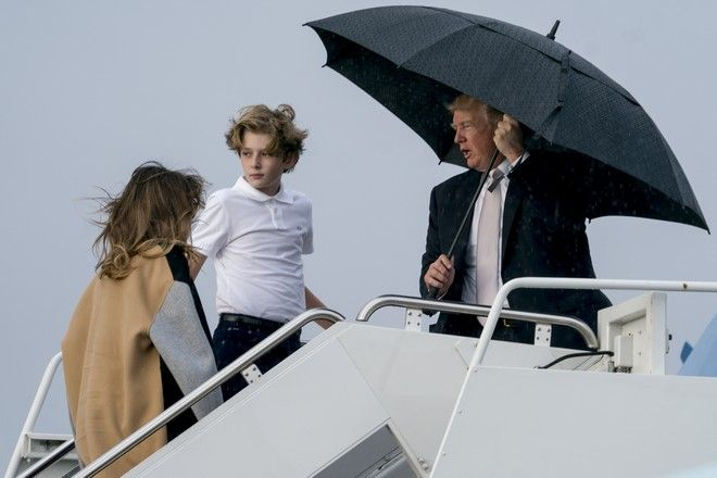 President Donald Trump, first lady Melania Trump, left, and their son Barron Trump board Air Force One at Palm Beach International Airport in West Palm Beach, Fla., Monday, Jan. 15, 2018, to travel to Washington. President Trump spent the holiday weekend at Mar-a-Lago, his club in Palm Beach, Fla. (AP Photo/Andrew Harnik)