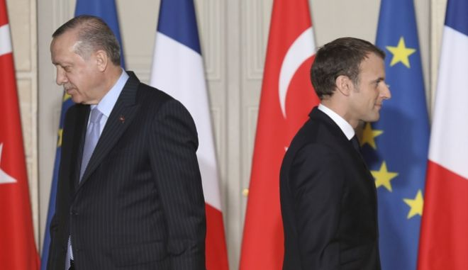 Turkish President Recep Tayyip Erdogan, left, and French President Emmanuel Macron arrives for a press conference at the Elysee Palace in Paris, Friday, Jan.5, 2018. Erdogan is traveling to Paris for talks with Macron, amid protests over press freedom and the deteriorating state of human rights in Turkey. (Ludovic Marin, Pool via AP)