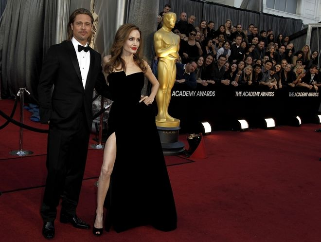 Brad Pitt, left, and Angelina Jolie arrive before the 84th Academy Awards on Sunday, Feb. 26, 2012, in the Hollywood section of Los Angeles. (AP Photo/Matt Sayles)