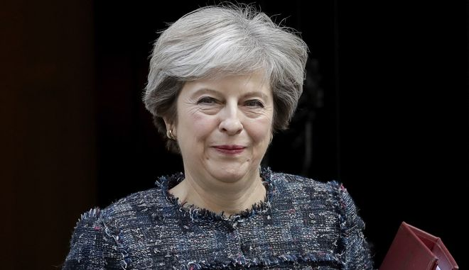 British Prime Minister Theresa May leaves 10 Downing Street in London, to attend Prime Minister's Questions at the Houses of Parliament, Wednesday, Sept. 13, 2017. (AP Photo/Matt Dunham)
