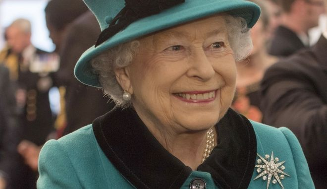 Britain's Queen Elizabeth II visits HMS Sutherland, a Type 23 frigate, in the West India Dock, London, Monday Oct. 23 2017.  The queen met a number of personnel on the upper deck, and had lunch and then joined the Ship's Company on the Flight Deck for a group photograph. (Arthur Edwards/Pool Photo via AP)