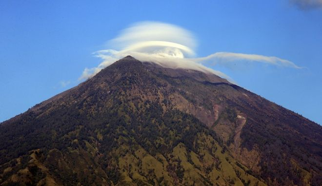 Mount Agung volcano is seen in Karangasem, Bali, Indonesia, Wednesday, Oct. 4, 2017. More than 140,000 people have fled from the surrounds of Mount Agung since authorities raised the volcano's alert status to the highest level on Sept. 22 after a sudden increase in tremors. It last erupted in 1963, killing more than 1,000 people. (AP Photo/Firdia Lisnawati)