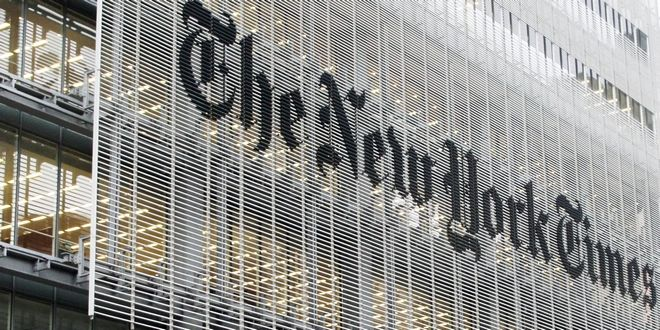 People pass the New York Times building in New York,  Wednesday, Oct. 10, 2012. The New York Times Co.'s stock rose on Thursday, Oct. 11, 2012,  after an analyst raised his rating and price target on the shares. (AP Photo/Richard Drew)