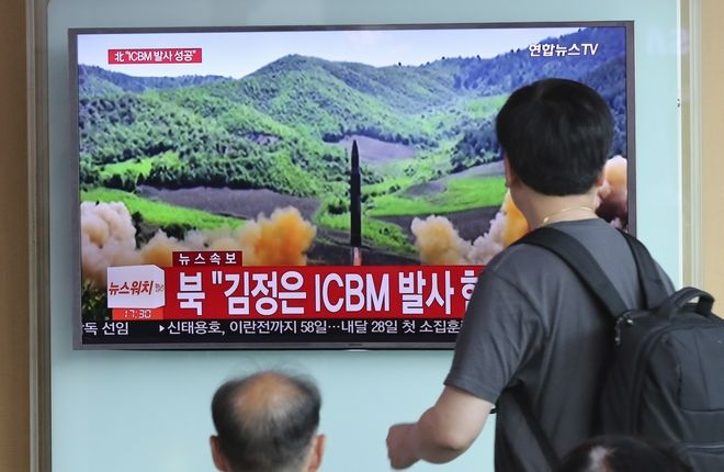 People watch a local TV news showing what was said to be the launch of a Hwasong-14 intercontinental ballistic missile, ICBM, aired by North Korea's KRT, at Seoul Train Station in Seoul, South Korea, Tuesday, July 4, 2017. North Korea claimed to have tested its first intercontinental ballistic missile in a launch Tuesday, a potential game-changing development in its push to militarily challenge Washington  but a declaration that conflicts with earlier South Korean and U.S. assessments that it had an intermediate range. The part of letters on the bottom