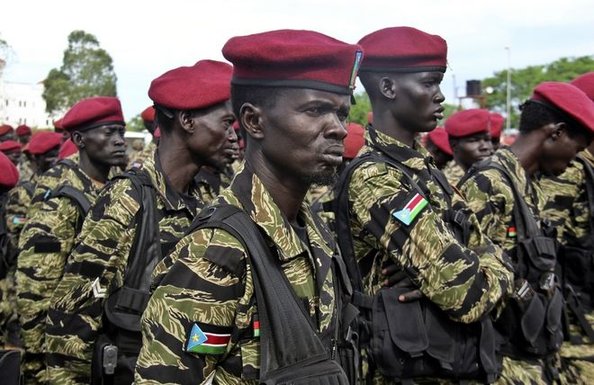 A soldier from South Sudan's Republican Guard Division, also known as the presidential guard and the Tiger Division, attends a ceremony marking the 34th anniversary of the Sudan People's Liberation Army (SPLA), in the capital Juba, South Sudan Thursday, May 18, 2017. South Sudan's civil war has killed tens of thousands and driven out more than 1.5 million people in the past three years, creating the world's largest refugee crisis. (AP Photo/Samir Bol)