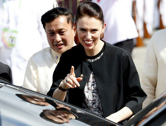 New Zealand Prime Minister Jacinda Ardern gestures upon arrival at Clark International Airport in Clark, Pampanga province, north of Manila, Philippines Sunday, Nov. 12, 2017. Prime Minister Ardern is one of more than a dozen leaders who will be attending the 31st ASEAN Summit and Related Summits in Manila. (AP Photo/Bullit Marquez)