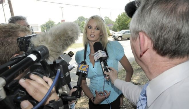 Porn star Stormy Daniels, who says she plans to make a serious run against incumbent U.S. Sen. David Vitter, talks with the media outside of the Southfield Grill in Shreveport, La., on Friday, July 3, 2009. Daniels was told by restaurant managers that she could eat at the establishment, but that she could not speak to customers. Media was also not allowed inside. (AP Photo/The Shreveport Times, Greg Pearson) **NO SALES, MAGS OUT, TV OUT, MANDATORY CREDIT: SHREVEPORTTIMES.COM**