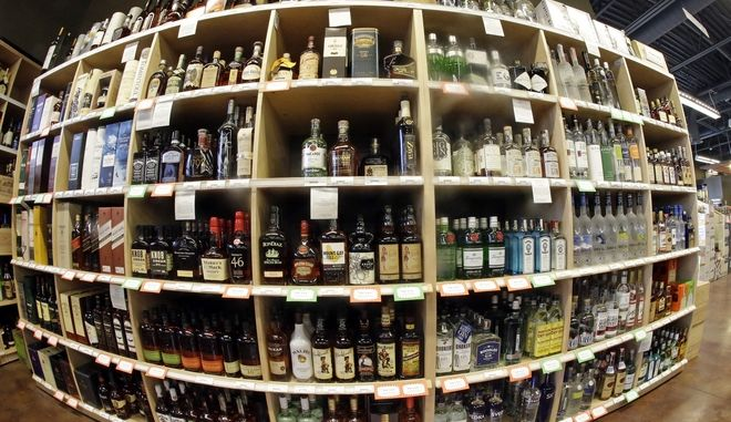FILE - This June 16, 2016, file photo, taken with a fisheye lens, shows bottles of alcohol during a tour of a state liquor store, in Salt Lake City. Cheap liquor, wine and beer have long been best-sellers among Utah alcohol drinkers, but new numbers from Utah's tightly-controlled liquor system show local craft brews, trendy box wines and flavored whiskies are also popular choices in a largely teetotaler state. (AP Photo/Rick Bowmer, File)