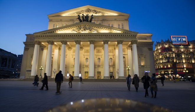 In this photo taken on Friday, April  8, 2016, People walk past the Bolshoi Theater in Moscow, Russia. Just a few weeks into the top creative job at Moscows Bolshoi Theater, Makhar Vaziev is making only one big promise _ he will keep doing what he says Russia does best, classical ballet. (AP Photo/Alexander Zemlianichenko)