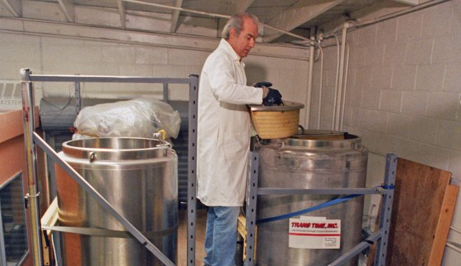 Art Quaife of the American Cryonics Society, opens a cryogenic storage capsule containing two frozen people at the Trans-Time warehouse in Oakland, Calif., April 22, 1987. For 150 members of he San Francisco-based ACS, freezing bodies and brains is a logical step towards immortality. (AP Photo/Paul Sakuma)