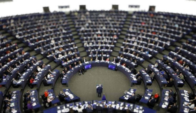 "In this image made with a tilt-shift lens, European Commission President Jean-Claude Juncker addresses the members of the European Parliament in Strasbourg, eastern France, to outline his reform plans for the European Union in the so-called State of the Union debate, Wednesday, Sept. 13, 2017. Juncker said the European Union is ""bouncing back"" after a tough decade that's seen much of the 28-country mired in an economic crisis and Britain vote to leave. (AP Photo/Jean-Francois Badias)"