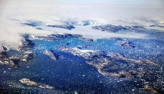 Icebergs float in a fjord after calving off from glaciers on the Greenland ice sheet in southeastern Greenland, Thursday, Aug. 3, 2017. The Greenland ice sheet, the second largest body of ice in the world which covers roughly 80 percent of the country, has been melting and its glaciers retreating at an accelerated pace in recent years due to warmer temperatures. If all of that ice melts, sea levels will rise by several meters, though there will be regional differences. (AP Photo/David Goldman)
