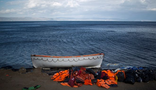 Life jackets used by refugees and migrants to cross the Aegean sea from the Turkish coast remain on the Greek island of Lesbos, Sunday, Nov. 22 , 2015. Greek authorities have started supplementary identity checks on immigrants reaching Athens by ferry from the country's eastern islands, after breaking up a ring that sold fake identity documents to migrants arriving on Lesbos. (AP Photo/Muhammed Muheisen)