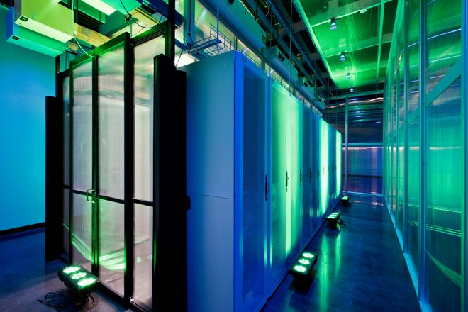 Empty server room with green and blue lights