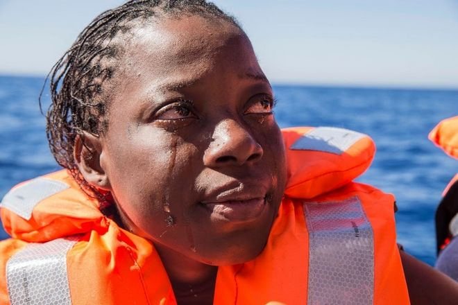 A woman from Ivory Cost cries after been rescued by MSF.  The MSF ship Dignity 1, that set sail from Malta after a technical stop, rescued 435 people from three boats in distress: 120 in the first one, 134 in the second and 181 in the third. On the first two boats, both rubber rafts, the majority were from Guinea, Mali, Ivory Coast and Senegal. The third boat however was wooden, and almost half of those onboard were from Eritrea. Between the three boats, 73 women were rescued as well as 140 children/minors. Whilst all are physically quite well, they show the scars of the perilious sea journey and awful time in Libya.