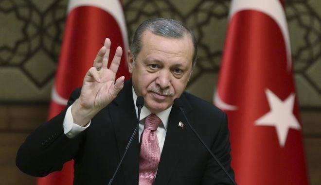 """Turkey's President Recep Tayyip Erdogan gestures as he addresses local administrators, in Ankara, Turkey, Wednesday, Feb. 8, 2017. In a sign of ameliorating ties, Turkish officials said Wednesday that U.S. President Donald Trump looked """"positively"""" on two key Turkish demands that had soured relations with the Obama administration, during a telephone conversation with Erdogan. (Yasin Bulbul/Pool photo via AP)"""
