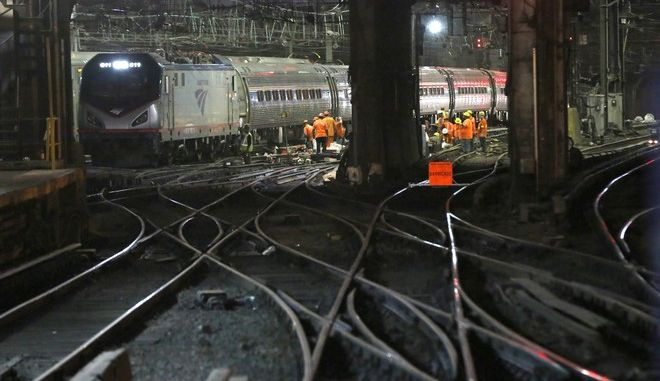 Amtrak workers continue ongoing infrastructure renewal work beneath Penn Station, Sunday, July 9, 2017, in New York. The work includes a series of major projects that will strengthen and improve operations and reliability at North America's busiest transportation hub. A normal weekday sees more than 1,300 daily train movements at Penn Station with each of the station's 21 tracks in use every two minutes. The ongoing work will help increase service reliability and preserve the existing operational flexibility for the users of Penn Station.(AP Photo/Kathy Willens)