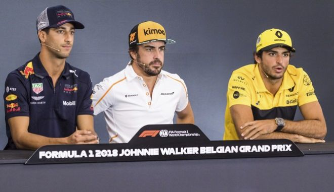 Red Bull driver Daniel Ricciardo of Australia, left, Mclaren driver Fernando Alonso of Spain, center, and Renault driver Carlos Sainz of Spain take part in a media conference ahead of the Belgian Formula One Grand Prix in Spa-Francorchamps, Belgium, Thursday, Aug. 23, 2018. The Belgian Formula One Grand Prix will take place on Sunday, Aug. 26, 2018. (AP Photo/Geert Vanden Wijngaert)