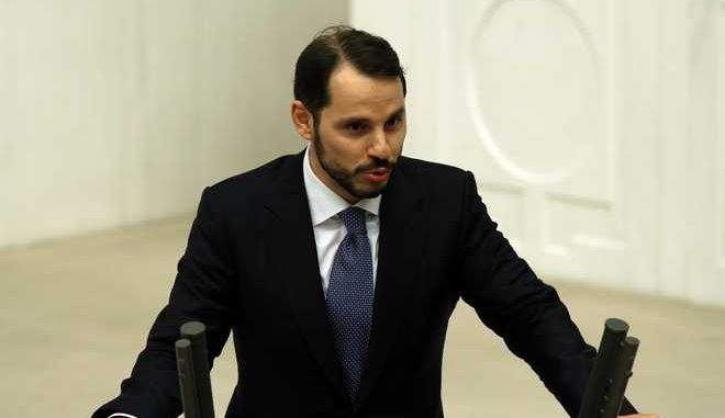 Berat Albayrak, the son-in-law of Turkey's President Recep Tayyip Erdogan and a newly elected legislator, takes his oath during the Turkish parliaments first session in Ankara, Turkey, on Tuesday, June 23, 2015. The ruling Islamic-rooted Justice and Development Party (AKP) came out first in the June 7 elections but lost its parliamentary majority. (AP Photo/Burhan Ozbilici)