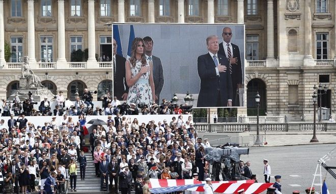 President Donald Trump and French President Emmanuel Macron during Bastille Day parade on the Champs Elysees avenue in Paris, Friday, July 14, 2017. (AP Photo/Carolyn Kaster)