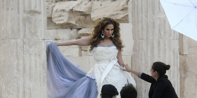 American actress, singer and  fashion designer Jennifer Lopez poses inside the ancient temple of Erechtheion, on the Acropolis hill during a photo shoot for her fashion label in Athens, Greece on Sunday, Sept 21, 2008. (AP Photo/Ilias Koutoulogenis)