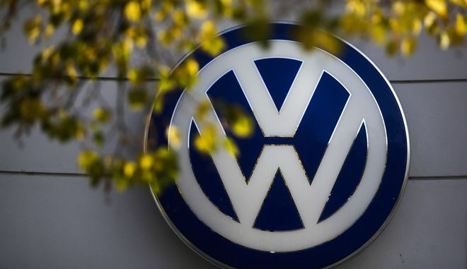 FILE - In this Oct. 5, 2015, file photo, the VW sign of Germany's Volkswagen car company is displayed at the building of a company's retailer in Berlin. Volkswagen is scheduled to present its third quarter figures Thursday, Oct. 27, 2016. (AP Photo/Markus Schreiber, File)