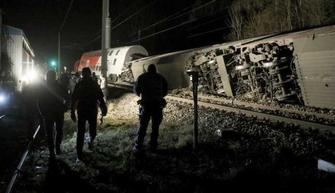 Rescue personnel and rail workers at the scene of a train crash in Kritzendorf, Austria, Friday, Dec. 22, 2017. Two passenger trains collided near a station north of Austria's capital Friday, injuring several people, authorities said. The two regional trains collided near the station in Kritzendorf, about 18.2 kilometers (11.3 miles) north of Vienna. AP Photo/Ronald Zak)