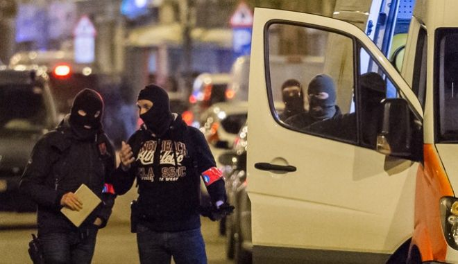 """Police investigate an area where terror suspect Mohamed Abrini was arrested earlier today, in Brussels on Friday April 8, 2016. The federal prosecutor's office confirmed a fugitive suspect in the Nov. 13 Paris attacks was arrested in Belgium on Friday, after a raid Belgian authorities said was linked to the deadly March 22 Brussels bombings. The suspect, Mohamed Abrini, is believed to be the mysterious """"man in the hat"""" who escaped the double bombing at Brussels airport, but further investigation is needed to determine Abrini is the third suspect of the airport attack. (AP Photo/Geert Vanden Wijngaert)"""