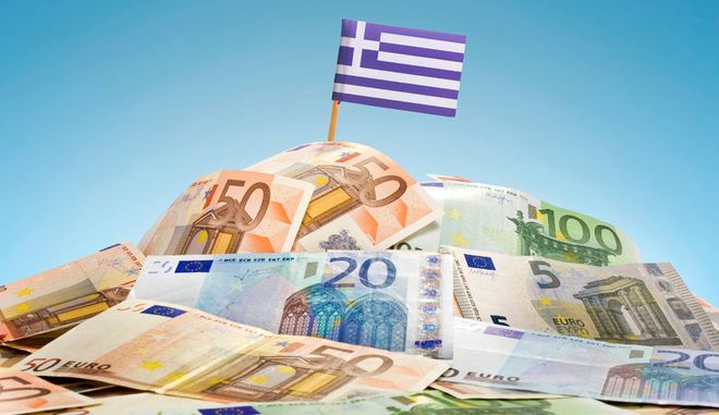 41392243 - the national flag of greece sticking in a pile of mixed european banknotes.(series)