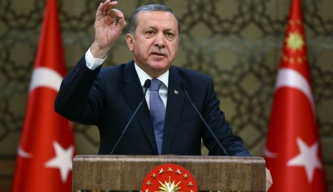 "Turkey's President, Recep Tayyip Erdogan, addresses local administrators at his palace in Ankara, Turkey, Wednesday, Feb. 24, 2016. Erdogan says his country supports the cease-fire agreement for Syria ""in principle"" but voices serious concern that the proposed truce will strengthen Syrian President Bashar Assad and lead to ""new tragedies."" Erdogan also said a U.S.-backed Syrian Kurdish militia group  which Turkey regards as a terror organization  should also be kept outside of the scope of the agreement. (Presidential Press Service/Kayhan Ozer, Pool via AP )"