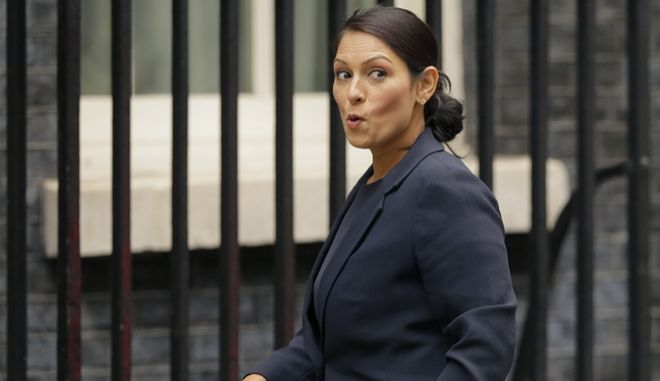 """FILE - In this Tuesday, Oct. 10, 2017 file photo, Britain's Secretary of State for International Development Priti Patel reacts to a question from the media as she arrives for a cabinet meeting at 10 Downing Street in London. Running for election mere months ago, British Prime Minister Theresa May's slogan was """"strong and stable government."""" The phrase sounds cruelly ironic now, with several senior members of May's Cabinet under fire for missteps or under investigation for alleged sexual misconduct. The latest bad news came when it emerged this week that International Development Secretary Priti Patel held 12 meetings with Israeli groups and officials, including Prime Minister Benjamin Netanyahu, while she was on vacation in the country in August - and that she hadn't told the prime minister or colleagues about it. (AP Photo/Alastair Grant, file)"""