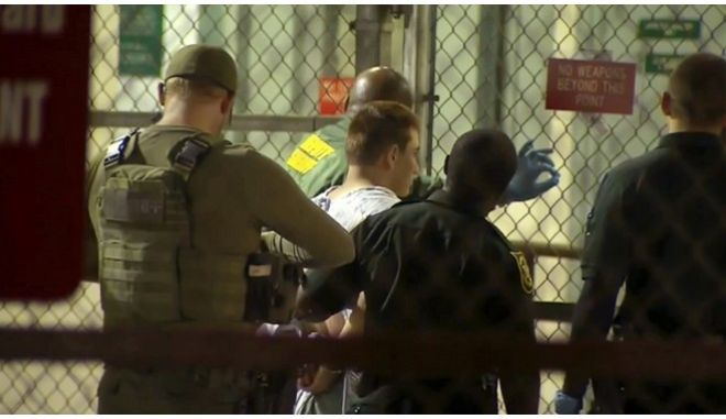 In this frame grab from video provided by WPLG-TV,  police take Nikolas Cruz into Broward County jail on Thursday, Feb. 15, 2018 in Fort Lauderdale, Fla.  Cruz was charged with 17 counts of premeditated murder Thursday morning after being questioned for hours by state and federal authorities.  (WPLG-TV via AP)