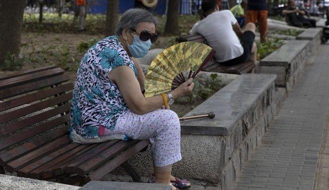 Γυναίκα με μάσκα στην Κίνα