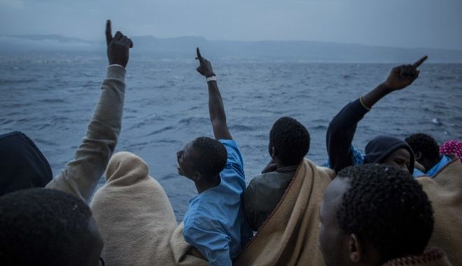 African refugees and migrants celebrate their arrival in Italy aboard the Golfo Azurro, the Spanish NGO Proactiva Open Arms rescue ship, after being rescued off the Libyan coast, on Saturday, Feb. 25, 2017. Rescuers found 332 people on Thursday in three separate rubber boats traveling north of the Libyan coast, according to Proactiva Open Arms, the nonprofit that operates the Golfo Azzurro rescue vessel. (AP Photo/Santi Palacios)