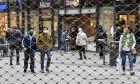 Πολίτες με μάσκες στη Γερμανία